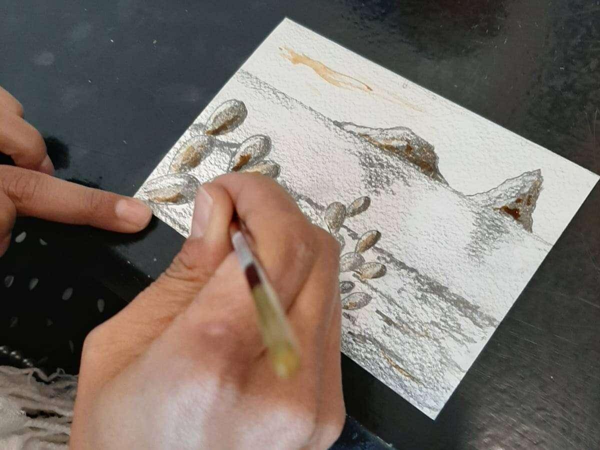Cartolina con matita, acquarello e caffè